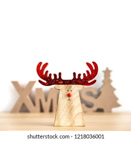 A Christmas decoration with xmas text and a reindeer