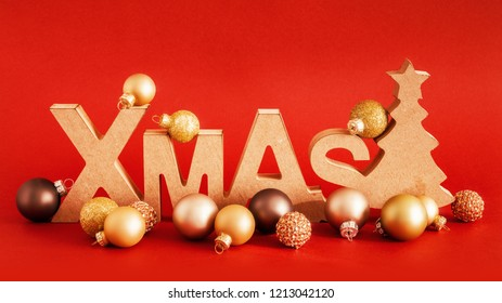 A Christmas decoration with xmas text and some glass balls