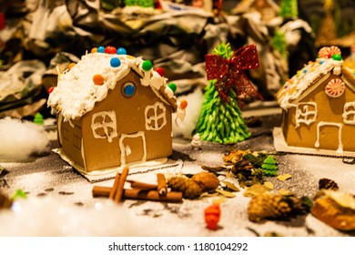 Christmas decorations against blurred background. Ginger houses with candies.