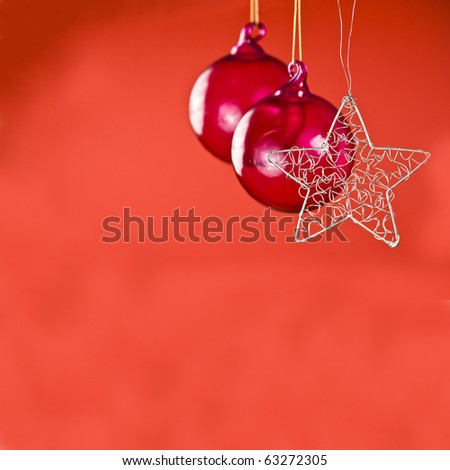 christmas decorations against a plain bright red background