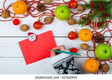 Christmas decorations and a blank sheet of paper on a wooden background. Letter to Santa, New Year card.