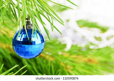 Christmas decorations of blue glass balls over bright background