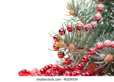 Christmas decorations with branch of Christmas tree on white background