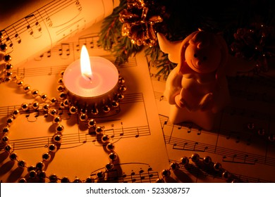 Christmas decorations, candles, figures of angels and notes in the dark