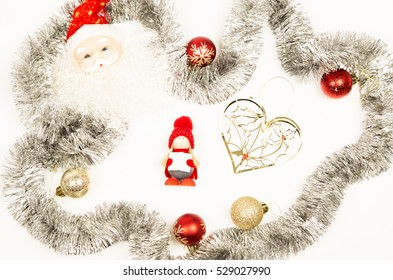 Christmas decorations ,card, yellow and red baubles ,glitter ,white background ,santa clause ,yellow ,heart ,caroler. ,winter