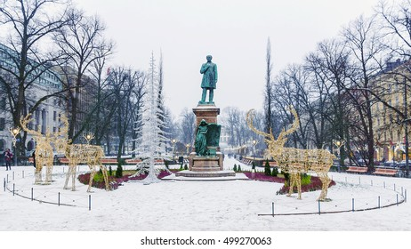 Christmas decorations City of Helsinki. Statue of Ludwig Runeberg in Esplanade Park