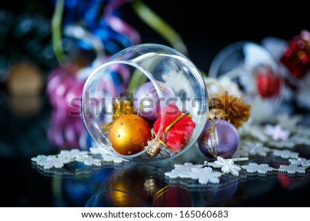 christmas decorations colored with ribbon on a black background