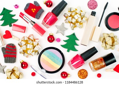 Christmas  decorations and cosmetic products on white background. Holiday and celebration creative concept. Flat lay, top view
