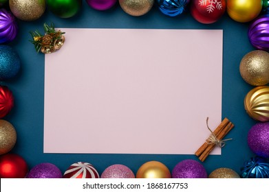 christmas decorations with a cup of coffee and sweets on a wooden table, clean sheet for text