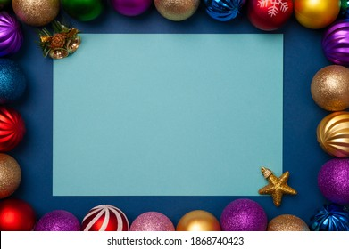 christmas decorations with a cup of coffee and sweets on a wooden table, top view and place for text