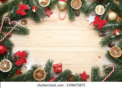 Christmas decorations with dry fruits on wooden table
