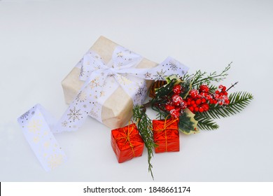 Christmas decorations ea white background. Christmas gift and spruce branch. New Year's gift in paper packaging. Happy new year. New year 2021