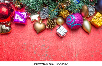 Christmas decorations and gift boxes on wooden board background