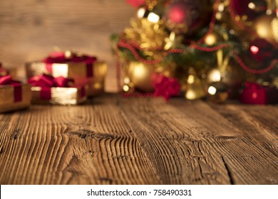 Christmas decorations and gifts on a rustic wooden background.