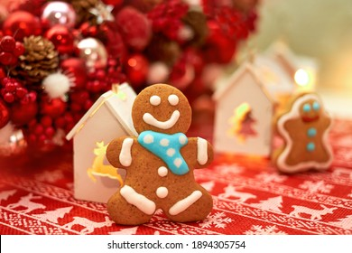 Christmas decorations with gingerbread man on a red background, Christmas balls, toy houses. Christmas background