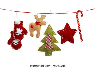 Christmas decorations hanging on a red ribbon isolated on a white background