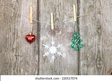 Christmas decorations hanging on a rope on the wooden background