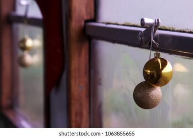 Christmas decorations hanging on train window
