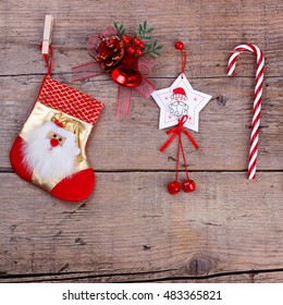Christmas decorations hanging over wooden background, festive card