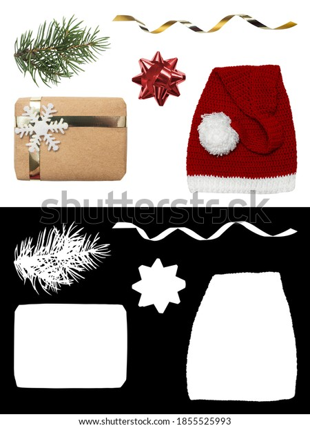 Christmas decorations isolated on white background with clipping mask. Cut branch of a Christmas tree, Santa hat, gift box, golden ribbon.
