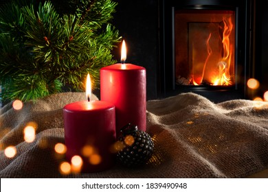 Christmas decorations with log fire and festive bokeh. Atmospheric christmas still life with fir tree and with candlelight on rustic linen sack. Space for your text.  - Shutterstock ID 1839490948