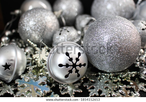 Christmas decorations for the New Year - balls in sparkles and beads. Preparations for dressing up the Christmas tree. The feeling of the approaching holiday. Cozy and beautiful home.