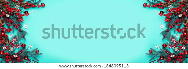 Christmas decorations on the blue background with copy space for your text. Banner.