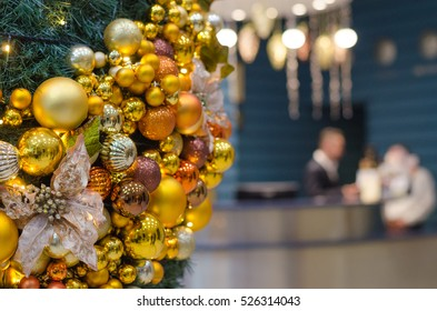 Christmas Decorations On Blue Modern Reception Desk In Hotel On Background