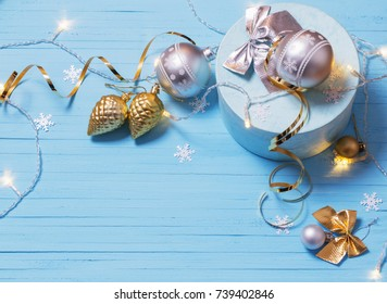 Christmas decorations on blue wooden background