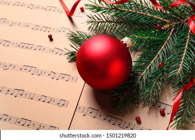 Christmas decorations on music sheets, space for text
