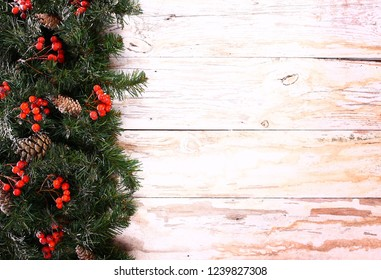 Christmas decorations on a white wooden free space.