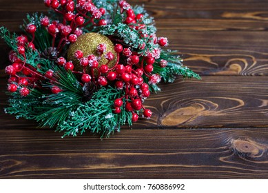 Christmas decorations on a wooden background, top view, space for your text.