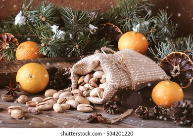Christmas decorations on wooden boards   (vintage style) with tangerines, cones, nuts