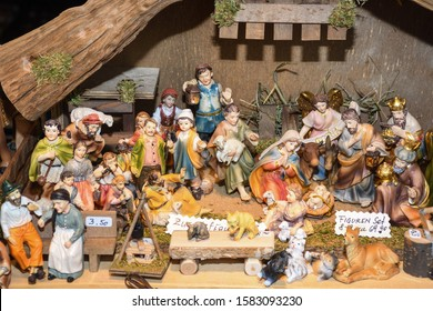 Christmas decorations and ornaments on the market in Vienna. For sale Christmas fair in Western Europe, Vienna, Austria. Biblical religious Christmas scene miniature figurines story Bible characters