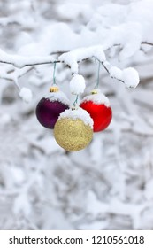 Christmas decorations outdoors covered in fresh snow