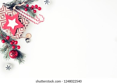 Christmas decorations over white background/top view