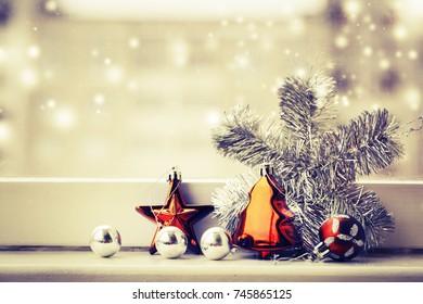 Christmas decorations over winter window