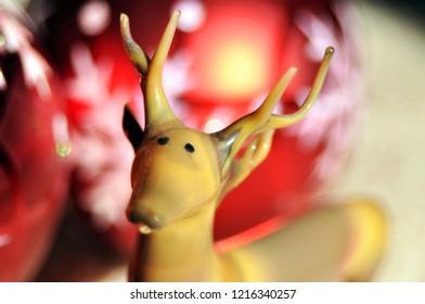Christmas decorations. Reindeer and red Christmas balls.
