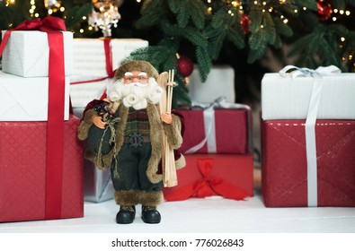 christmas decorations santa toy and presents and christmas tree