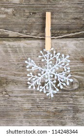 Christmas decorations, snowflake hanging over wooden background