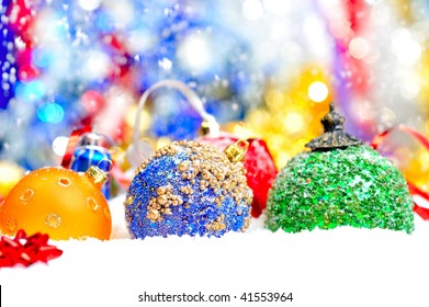 christmas decorations and snowflakes falling