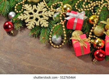 Christmas decorations and spruce branch on a wooden background