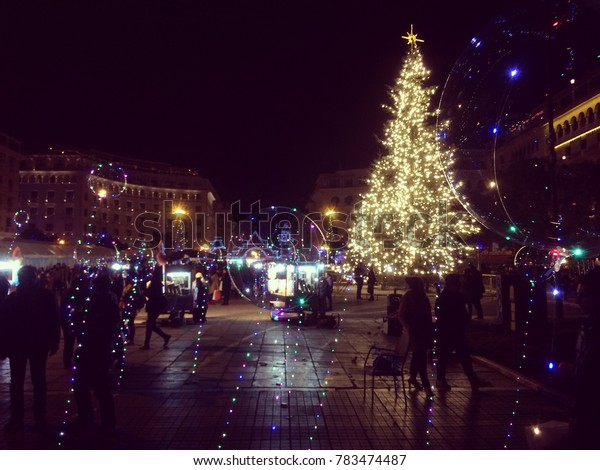 Christmas decorations at a square with a tree and lights at night in Thessaloniki, Greece