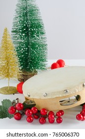 Christmas decorations with tambourine, tree, lollipops and red balls.