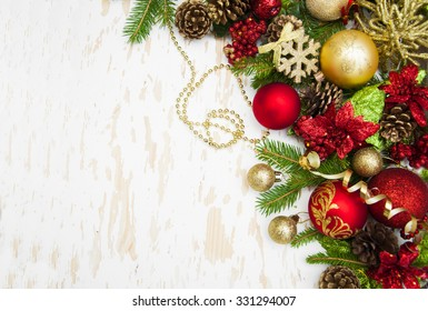 Christmas decorations,baubles,ribbon with Christmas tree on a wooden background