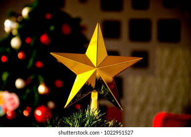 Christmas decorations,green,plastic tree with colorful ,plastic balls and stars