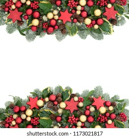 Christmas decorative background border with red and gold bauble decorations, holly berries, spruce pine, ivy, pine cones and mistletoe on white with copy space.