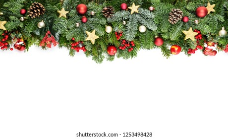 Christmas decorative background border with red bauble decorations, holly berries, spruce and pine cones