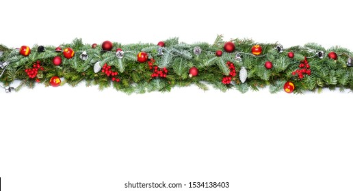 Christmas decorative background border with red bauble decorations and holly berries