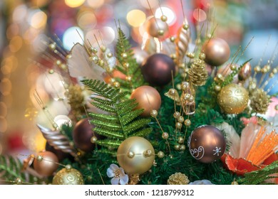 Christmas decorative basket with pine leaves, pine fruit, balls, golden flowers....